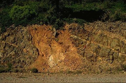 impact breccia dike in Paleozoic siltstones; road to Santuario de la Virgen de Herrera Azuara impact