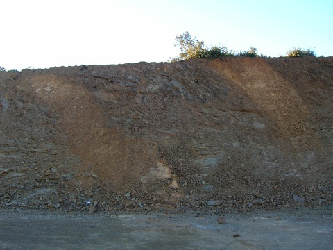 two thick impact breccia dikes cutting Paleozoic siltstones, Autovía Mudéjar Azuara impact structure