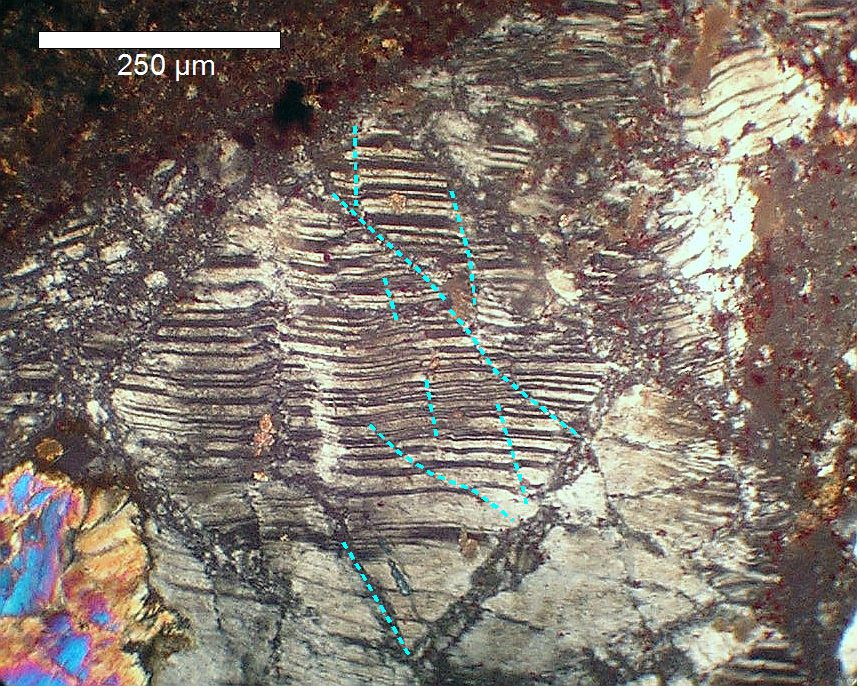 photomicrograph of kink bands and faults in feldspar, Siljan ring impact structure, Sweden
