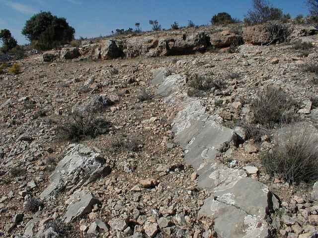 suevite (basal breccia) unconformity; central-uplift chain, Rubielos de la Cérida impact basin