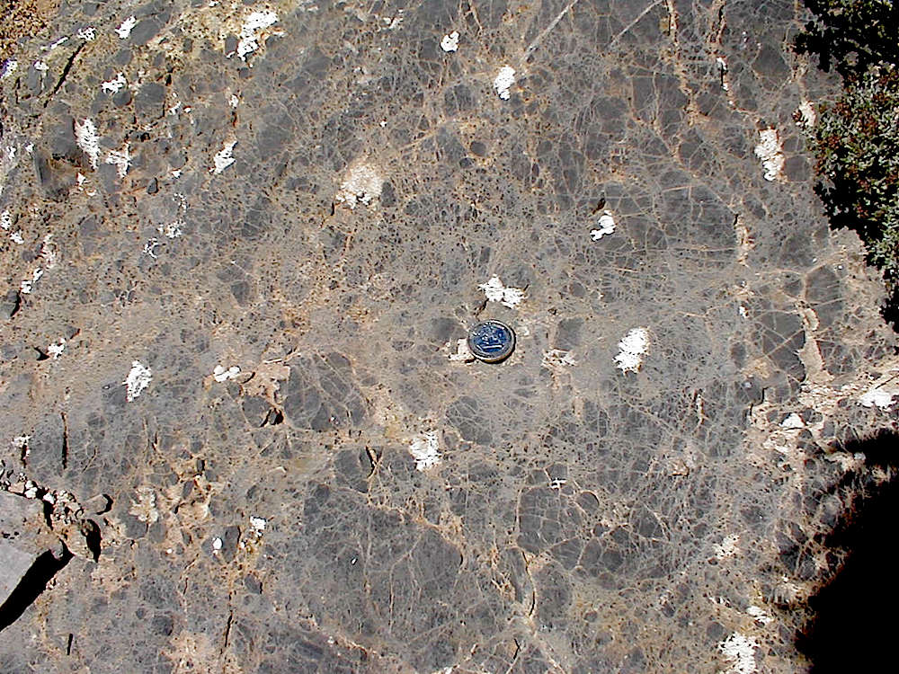 Monomictic movement breccia, grit and mortar brecciation, Rubielos de la Cérida impact basin rim zone
