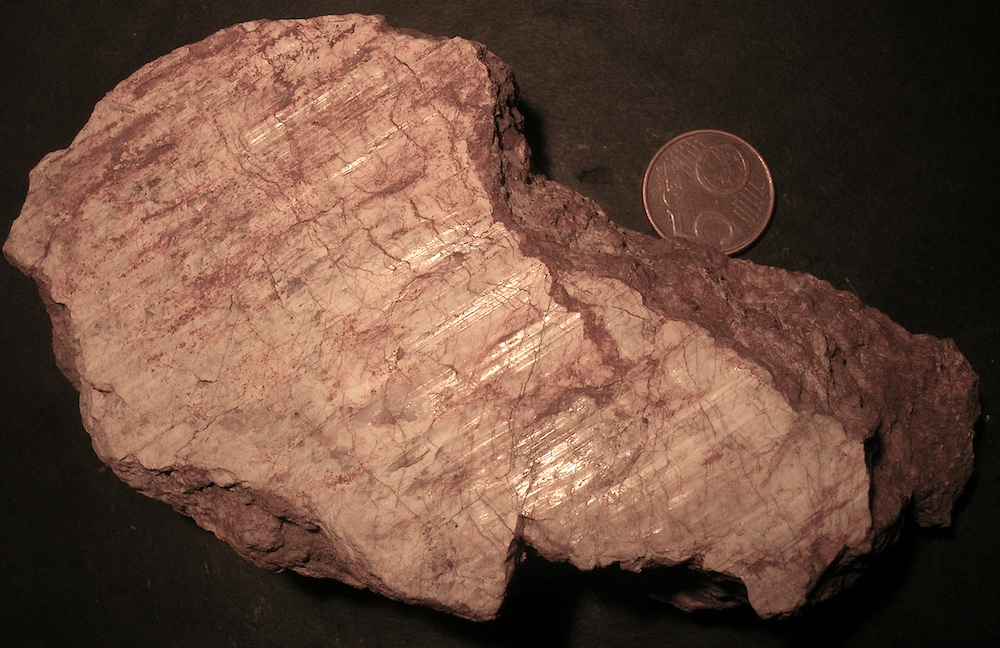 striated and polished surface of monomictic impact breccia, Fombuena, Azuara impact structure