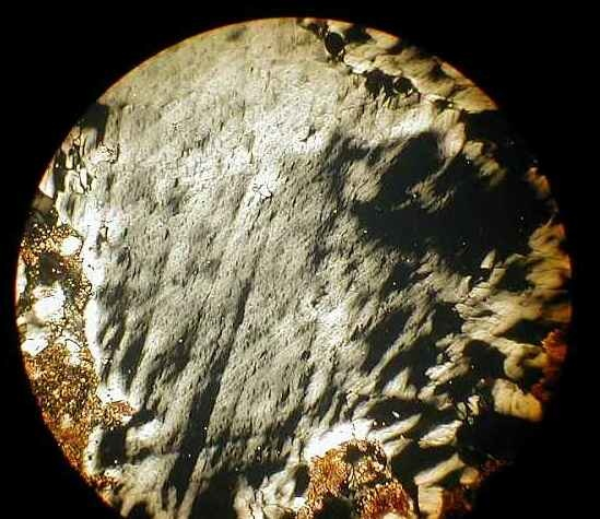 photomicrograph of shocked quartz with planar deformation features and diaplectic glass, Rubielos de la Cérida impact basinsandstone with tensile spallation fractures in quartz, Rubielos de la Cérida impact basin, Spain